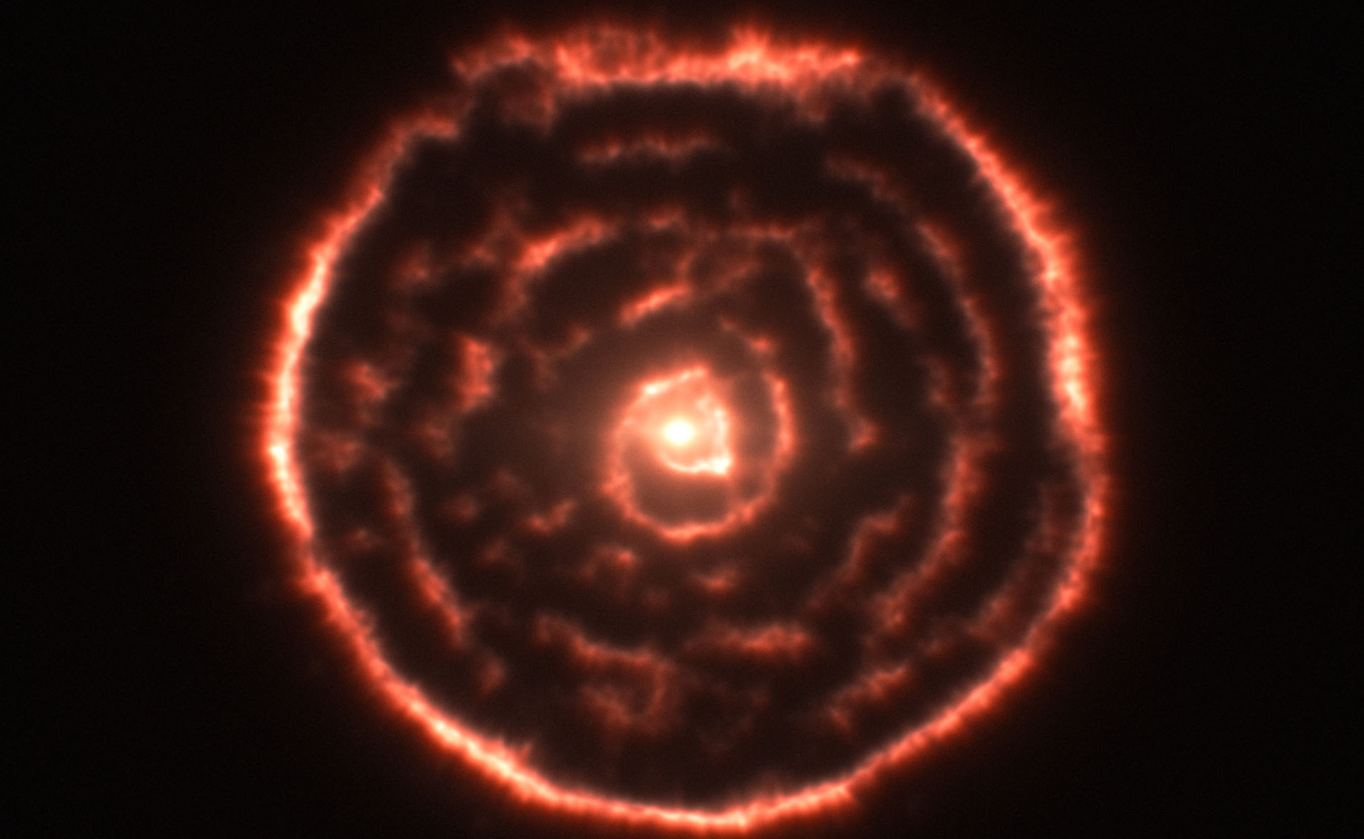 Observations using the Atacama Large Millimeter/submillimeter Array (ALMA) have revealed an unexpected spiral structure in the material around the old star R Sculptoris. This feature has never been seen before and is probably caused by a hidden companion star orbiting the star. This slice through the new ALMA data reveals the shell around the star, which shows up as the outer circular ring, as well as a very clear spiral structure in the inner material.